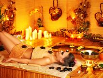 Woman getting stone therapy massage . Royalty Free Stock Photo