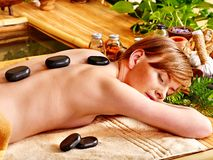 Woman getting stone therapy massage . Stock Photography
