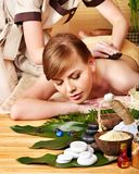 Woman getting stone therapy massage . Royalty Free Stock Images