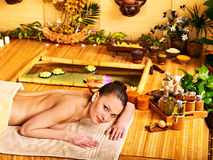 Woman getting stone therapy massage . Stock Images