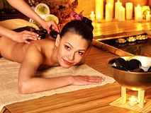 Woman getting stone therapy massage . Royalty Free Stock Photos