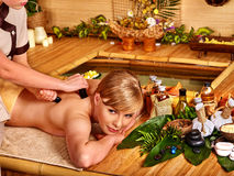 Woman getting stone therapy massage Stock Image