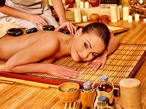 Woman getting stone therapy massage Stock Photography