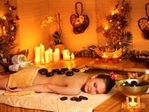 Woman getting stone therapy massage Stock Images