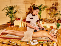 Woman getting stone therapy massage Royalty Free Stock Photo