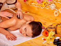 Woman getting stone therapy massage Royalty Free Stock Images
