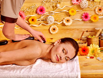 Woman getting stone therapy massage Royalty Free Stock Photos