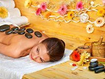 Woman getting stone therapy massage . Stock Photos