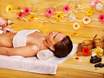 Woman getting stone therapy massage . Stock Image