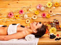 Woman getting stone therapy massage Stock Photo