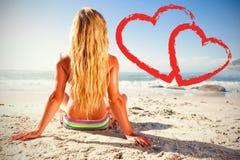 A woman getting a tan Stock Photo