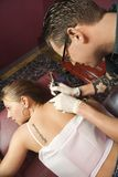 Woman getting tattoo. Royalty Free Stock Photography