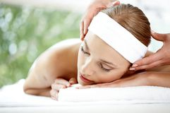 Woman Getting Temple Massage Royalty Free Stock Image