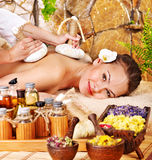 Woman getting thai herbal compress massage . Woman getting thai herbal compress massage in spa royalty free stock photography