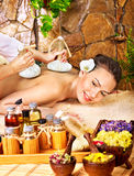 Woman getting thai herbal compress massage . Royalty Free Stock Images