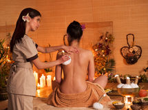Woman getting thai herbal massage ball Royalty Free Stock Photos