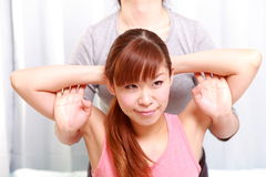 Woman Getting Thai Massage Stock Images