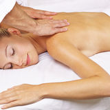 Woman getting thai massage in day spa Royalty Free Stock Photo
