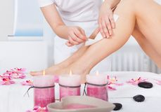 Woman getting thigh massage Stock Image