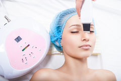 Woman getting ultrasound skin cleaning Stock Photos