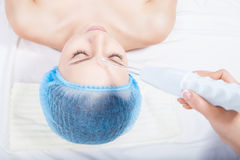 Woman getting ultrasound skin cleaning Stock Photo