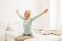 Woman getting up Royalty Free Stock Photography