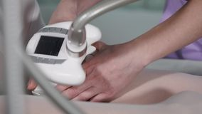 Woman getting  vacuum massage on legs in beauty salon. stock footage