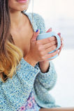 Woman getting warm with hot tea Stock Images