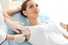 Woman getting wax epilation. In salon royalty free stock photography