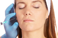 Woman getting wrinkles removed Royalty Free Stock Photography
