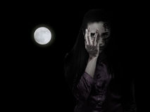 Woman with ghost make up in the dark Stock Photography