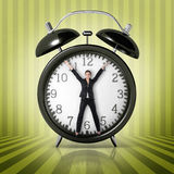 Woman in a giant clock Stock Image