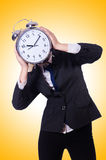 Woman with giant clock Stock Photography