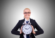 Woman with giant clock on white Stock Photo