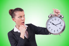 Woman with giant clock on white Royalty Free Stock Photos