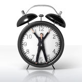 Woman in a giant clock Royalty Free Stock Images