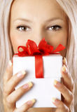 Woman and gift Royalty Free Stock Photography