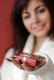 Woman with gift. Woman giving gift with hand and gift on focus Stock Photos