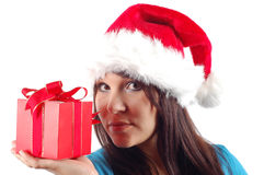 Woman with gift #12. Attractive woman with santa claus hat and gift on white background Stock Photo