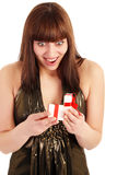 Woman with gift. Woman opening gift box on white background Stock Photography