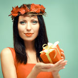 Woman with gift Royalty Free Stock Images