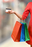 Woman with a gift bag and a credit card Stock Photography