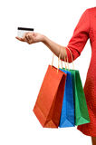 Woman with a gift bag and a credit card Stock Image
