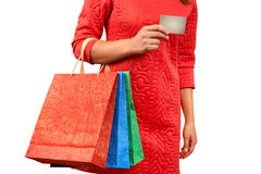 Woman with a gift bag and a credit card Stock Images