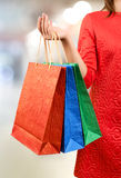 Woman with a gift bag Stock Photos