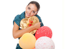 Woman with gift and balloons happy birthday. Young woman with gift and balloons for happy birthday over white background Stock Photo