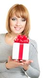 Woman with gift-box. Beautiful young smiling woman with gift on white background Royalty Free Stock Photo