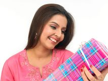 Woman with a gift box. Young indian origin woman with a gift box Stock Images