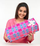 Woman with a gift box. Beautiful young origin asian woman with a gift box Royalty Free Stock Image