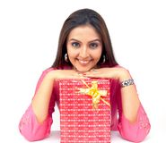 Woman with a gift box. Beautiful young origin asian woman with a gift box Stock Images